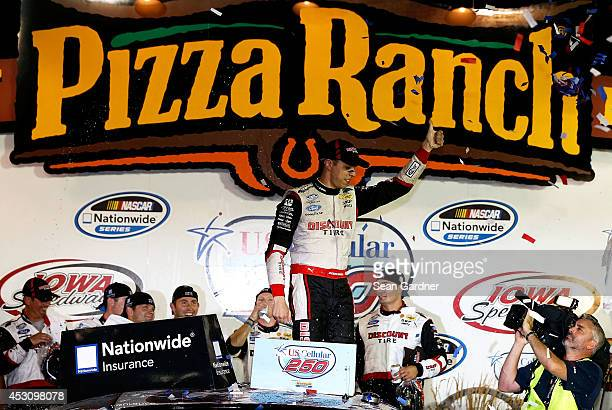 Brad Keselowski driver of the Discount Tire Ford celebrates in victory lane after winning the NASCAR Nationwide Series US Cellular 250 Presented by...