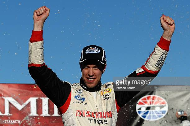 Brad Keselowski driver of the Discount Tire Ford celebrates in Victory Lane after winning the NASCAR Nationwide Series Boyd Gaming 300 at Las Vegas...
