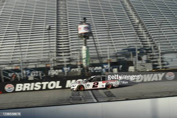 Brad Keselowski, driver of the Discount Tire Ford, crosses the finish line to win the NASCAR Cup Series Food City presents the Supermarket Heroes 500...