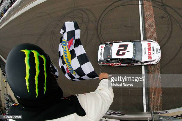 Brad Keselowski driver of the Discount Tire Ford crosses the line to win the Monster Energy NASCAR Cup Series Big Machine Vodka 400 at the Brickyard...