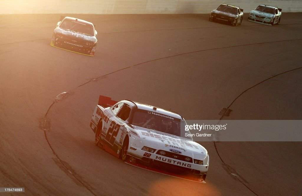 Brad Keselowski, driver of the #22 Discount Tire Ford, leads a group of cars during the NASCAR Nationwide Series U.S. Cellular 250 Presented by Enlist Weed Control System at Iowa Speedway on August 3, 2013 in Newton, Iowa.