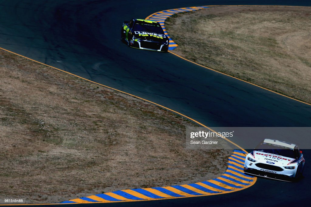 Brad Keselowski, driver of the #2 Discount Tire Ford, leads Jimmie Johnson, driver of the #48 Lowe's for Pros Chevrolet, practice for the Monster Energy NASCAR Cup Series Toyota/Save Mart 350 at Sonoma Raceway on June 22, 2018 in Sonoma, California.