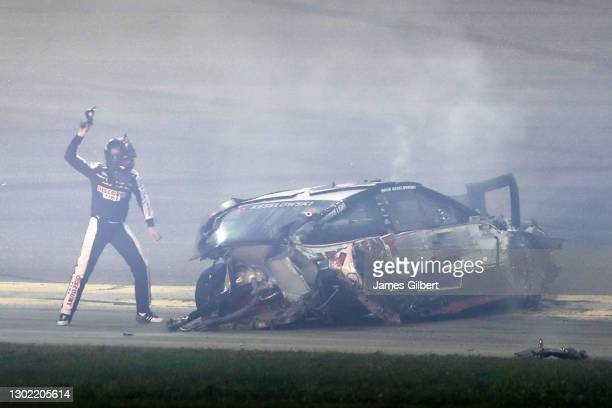 Brad Keselowski, driver of the Discount Tire Ford, reacts after are involved in an on-track incident after the NASCAR Cup Series 63rd Annual Daytona...