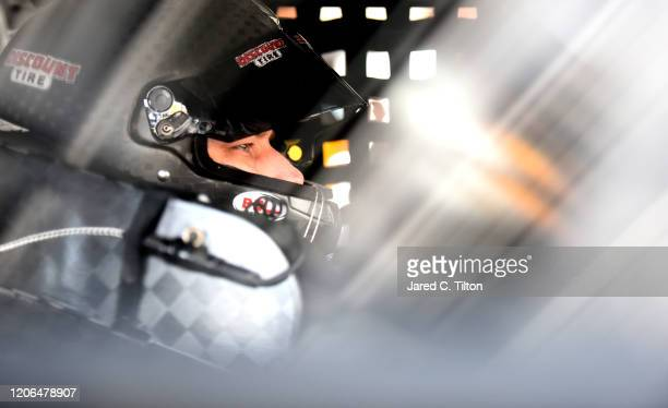 Brad Keselowski driver of the Discount Tire Ford sits in his car during practice for the NASCAR Cup Series 62nd Annual Daytona 500 at Daytona...