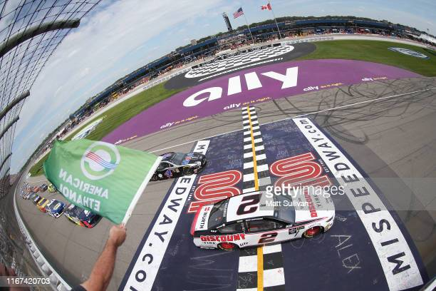 Brad Keselowski driver of the Discount Tire Ford takes the green flag to start the Monster Energy NASCAR Cup Series Consumers Energy 400 at Michigan...