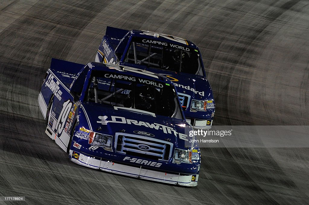 Brad Keselowski, driver of the #19 Draw Tite Ford, races with Ryan Blaney, driver of the #29 Cooper Standard Ford during the Camping World Truck Series UNOH 200 at Bristol Motor Speedway on August 21, 2013 in Bristol, Tennessee.