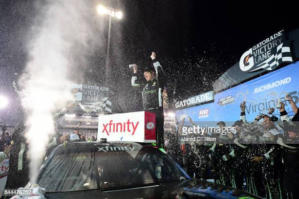 Brad Keselowski driver of the Fitzgerald Glider Kits Ford celebrates in Victory Lane after winning the NASCAR XFINITY Series Virginia529 College...