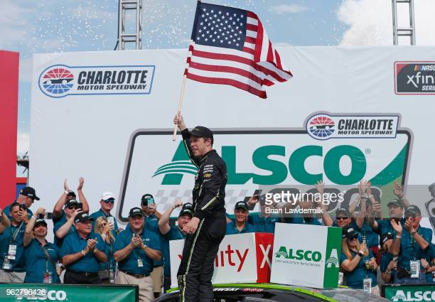 Brad Keselowski driver of the Fitzgerald Glider Kits Ford celebrates in victory lane after winning the NASCAR Xfinity Series ALSCO 300 at Charlotte...