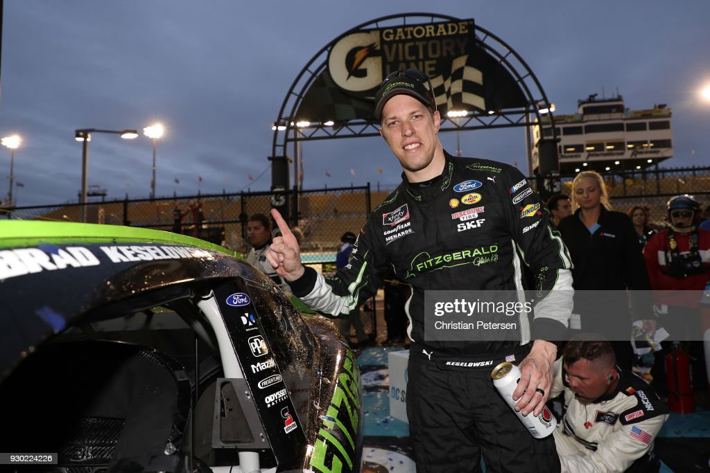 Brad Keselowski, driver of the #22 Fitzgerald Glider Kits Ford, poses with the winner's decal in Victory Lane after winning the NASCAR Xfinity Series DC Solar 200 at ISM Raceway on March 10, 2018 in Avondale, Arizona.