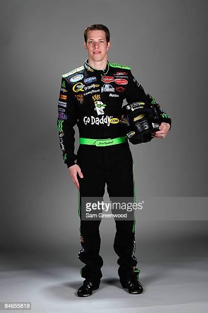 Brad Keselowski driver of the GoDaddycom Chevrolet poses during NASCAR media day at Daytona International Speedway on February 5 2009 in Daytona...