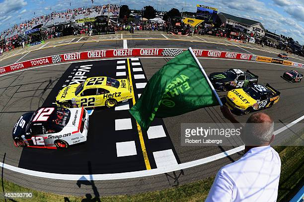 Brad Keselowski, driver of the Hertz Ford, and Joey Logano, driver of the Snap-On Ford, lead the field to the green flag for the running of the...