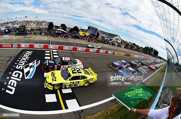 Brad Keselowski, driver of the Hertz Ford, and Joey Logano, driver of the Snap-on Ford, lead the field through the green flag to start the NASCAR...