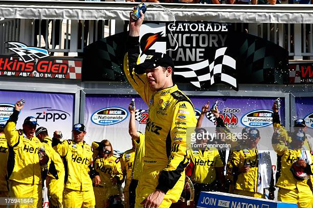 Brad Keselowski driver of the Hertz Ford celebrates in victory lane after winning the NASCAR Nationwide Series Zippo 200 at Watkins Glen...