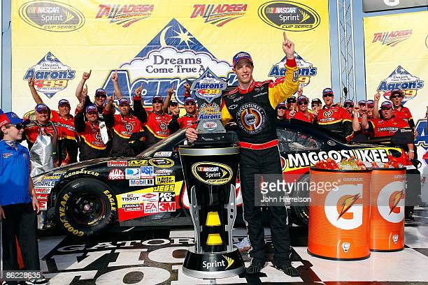 Brad Keselowski driver of the Miccosukee Chevrolet celebrates in victory lane after winning the NASCAR Sprint Cup Series Aaron's 499 at Talladega...
