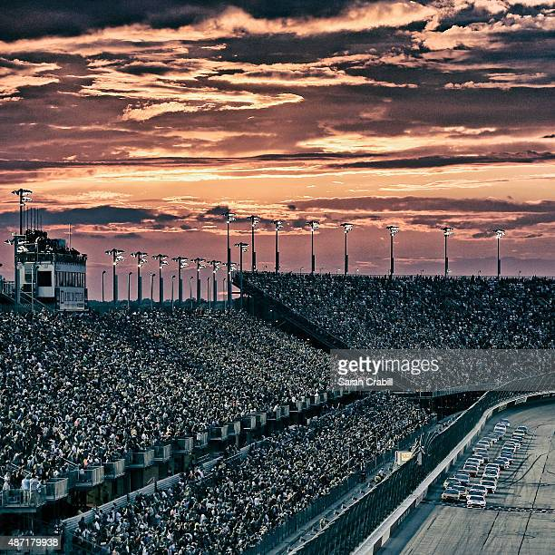 Brad Keselowski, driver of the Miller High Life Ford, and Kevin Harvick, driver of the Budweiser/Jimmy John's Chevrolet, lead the field to a restart...