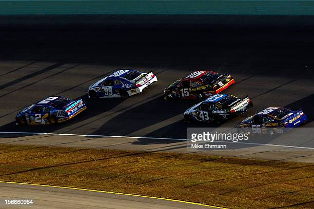 Brad Keselowski driver of the Miller Lite Dodge and Carl Edwards driver of the Fastenal Ford lead a group of cars during the NASCAR Sprint Cup Series...
