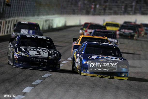 Brad Keselowski driver of the Miller Lite Dodge and Jimmie Johnson driver of the Lowe's Chevrolet race during the NASCAR Sprint Cup Series AAA Texas...