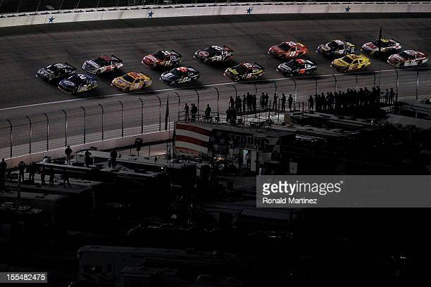 Brad Keselowski driver of the Miller Lite Dodge and Jimmie Johnson driver of the Lowe's Chevrolet lead the field to a restart during the NASCAR...