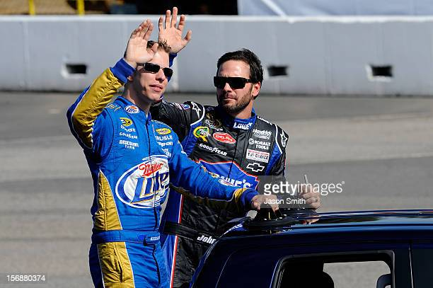 Brad Keselowski driver of the Miller Lite Dodge and Jimmie Johnson driver of the Lowe's Chevrolet wave to the fans during driver introductions for...