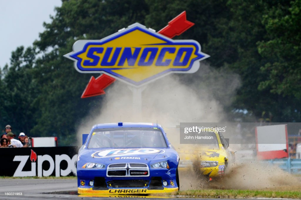 Brad Keselowski, driver of the #2 Miller Lite Dodge, and Marcos Ambrose, driver of the #9 Stanley Ford, battle for position during the NASCAR Sprint Cup Series Finger Lakes 355 at the Glen at Watkins Glen International on August 12, 2012 in Watkins Glen, New York.