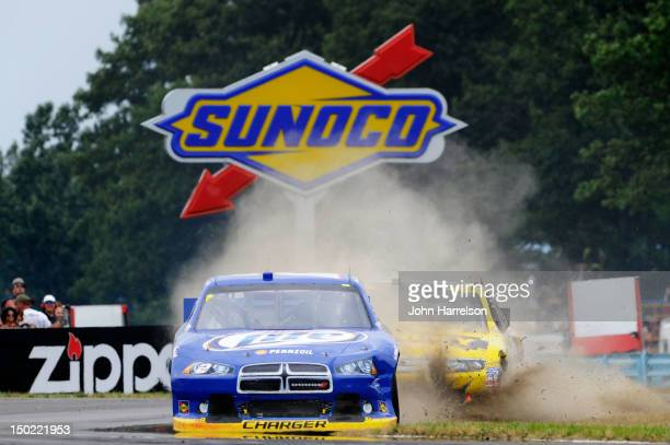Brad Keselowski, driver of the Miller Lite Dodge, and Marcos Ambrose, driver of the Stanley Ford, battle for position during the NASCAR Sprint Cup...
