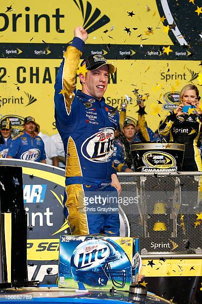 Brad Keselowski driver of the Miller Lite Dodge celebrates in Champions Victory Lane after winning the series championship and finishing in fifteenth...