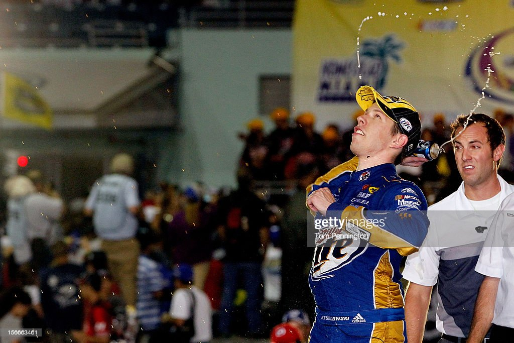 Brad Keselowski, driver of the #2 Miller Lite Dodge, celebrates in Champions Victory Lane after winning the series championship and finishing in fifteenth place for the NASCAR Sprint Cup Series Ford EcoBoost 400 at Homestead-Miami Speedway on November 18, 2012 in Homestead, Florida.
