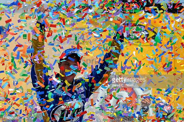 Brad Keselowski driver of the Miller Lite Dodge celebrates in Victory Lane after winning the NASCAR Sprint Cup Series STP 400 at Kansas Speedway on...
