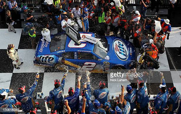 Brad Keselowski driver of the Miller Lite Dodge celebrates in victory lane after winning the NASCAR Sprint Cup Series Good Sam RV Insurance 500 at...