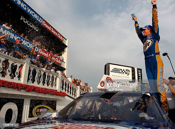 Brad Keselowski, driver of the Miller Lite Dodge, celebrates in victory lane after winning the NASCAR Sprint Cup Series Good Sam RV Insurance 500 at...