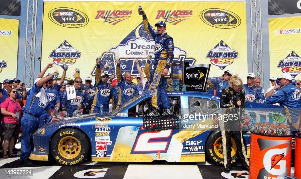 Brad Keselowski driver of the Miller Lite Dodge celebrates in Victory Lane after winning the NASCAR Sprint Cup Series Aaron's 499 at Talladega...
