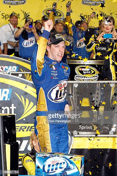 Brad Keselowski driver of the Miller Lite Dodge celebrates in Victory Lane after winning the series championship and finishing in fifteenth place for...