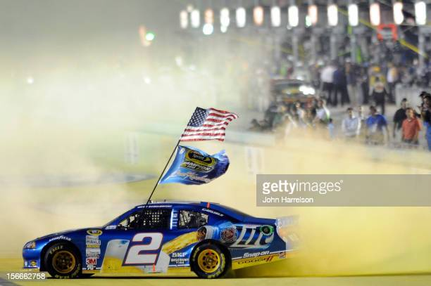 Brad Keselowski driver of the Miller Lite Dodge celebrates with a burnout after winning the series championship and finishing in fifteenth place for...