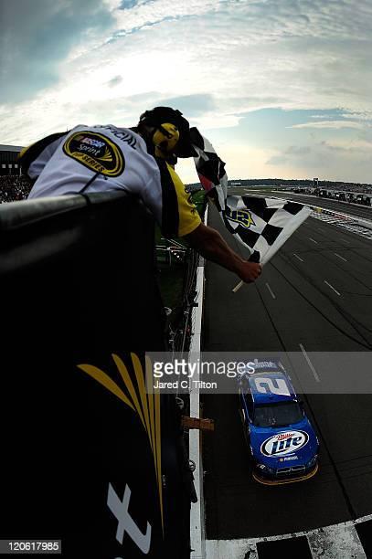 Brad Keselowski driver of the Miller Lite Dodge crosses the finish line to win the NASCAR Sprint Cup Series Good Sam RV Insurance 500 at Pocono...