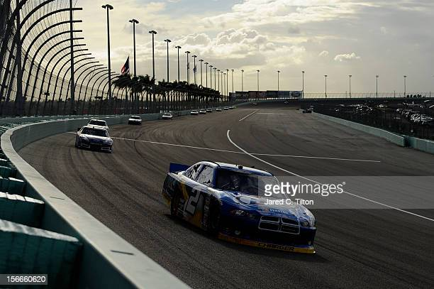 Brad Keselowski driver of the Miller Lite Dodge leads a group cars during the NASCAR Sprint Cup Series Ford EcoBoost 400 at HomesteadMiami Speedway...