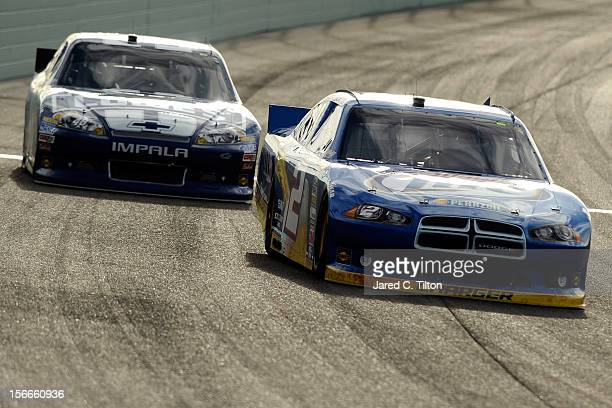 Brad Keselowski driver of the Miller Lite Dodge leads Jimmie Johnson driver of the Lowe's Chevrolet during the NASCAR Sprint Cup Series Ford EcoBoost...