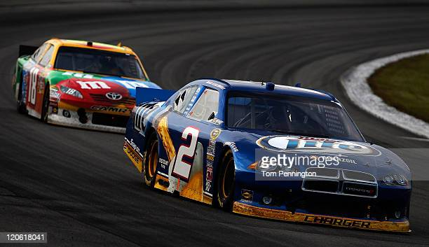 Brad Keselowski driver of the Miller Lite Dodge leads Kyle Busch driver of the MM's Toyota during the NASCAR Sprint Cup Series Good Sam RV Insurance...