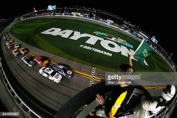 Brad Keselowski driver of the Miller Lite Ford and Chase Elliott driver of the NAPA Chevrolet lead the field to the green flag to start the Monster...