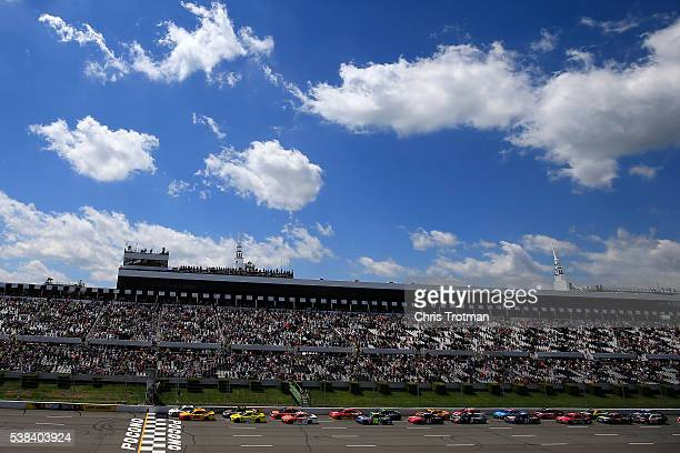 Brad Keselowski driver of the Miller Lite Ford and Joey Logano driver of the Shell Pennzoil Ford lead the field to the green flag to start the NASCAR...