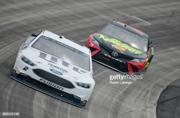 Brad Keselowski driver of the Miller Lite Ford and Martin Truex Jr driver of the 5hour ENERGY/Bass Pro Shops Toyota race during the Monster Energy...
