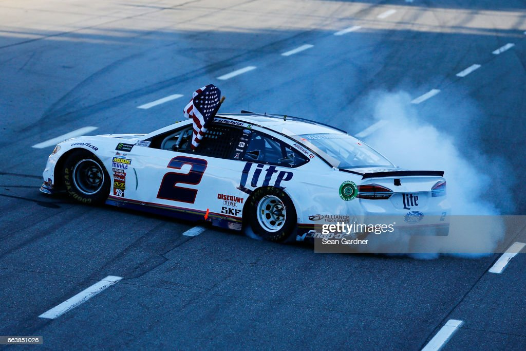 Brad Keselowski, driver of the #2 Miller Lite Ford, celebrates after winning the Monster Energy NASCAR Cup Series STP 500 at Martinsville Speedway on April 2, 2017 in Martinsville, Virginia.