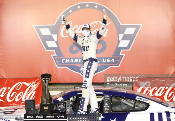 Brad Keselowski driver of the Miller Lite Ford celebrates in Victory Lane after winning the NASCAR Cup Series CocaCola 600 at Charlotte Motor...