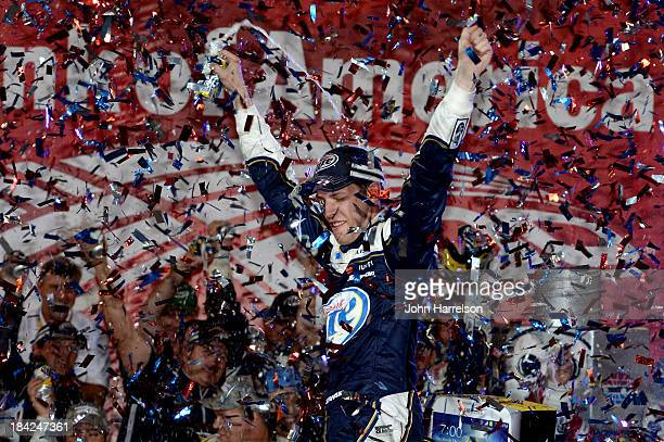 Brad Keselowski driver of the Miller Lite Ford celebrates in Victory Lane after winning the NASCAR Sprint Cup Series Bank of America 500 at Charlotte...