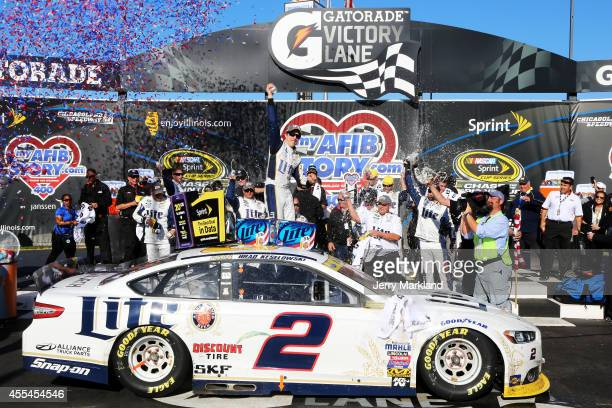 Brad Keselowski driver of the Miller Lite Ford celebrates in Victory Lane after winning during the NASCAR Sprint Cup Series MyAFibStorycom 400 at...