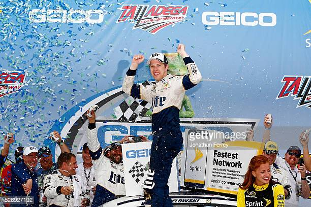 Brad Keselowski driver of the Miller Lite Ford celebrates in Victory Lane after winning the NASCAR Sprint Cup Series GEICO 500 at Talladega...