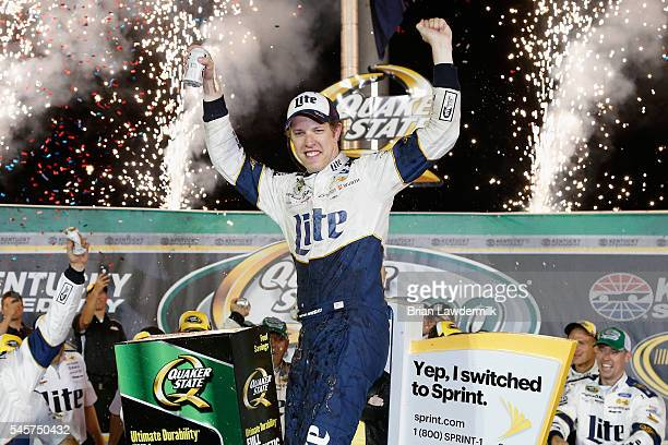Brad Keselowski driver of the Miller Lite Ford celebrates in Victory Lane after winning the NASCAR Sprint Cup Series Quaker State 400 at Kentucky...