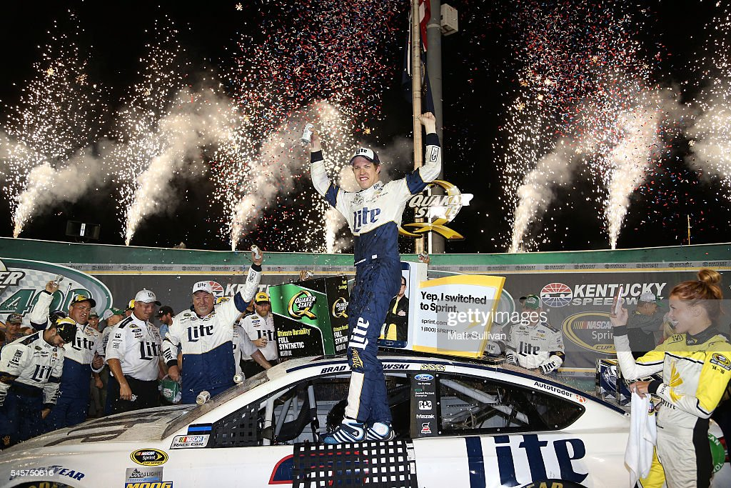 Brad Keselowski, driver of the #2 Miller Lite Ford, celebrates in Victory Lane after winning the NASCAR Sprint Cup Series Quaker State 400 at Kentucky Speedway on July 9, 2016 in Sparta, Kentucky.