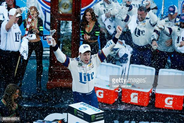 Brad Keselowski driver of the Miller Lite Ford celebrates in Victory Lane after winning the Monster Energy NASCAR Cup Series STP 500 at Martinsville...