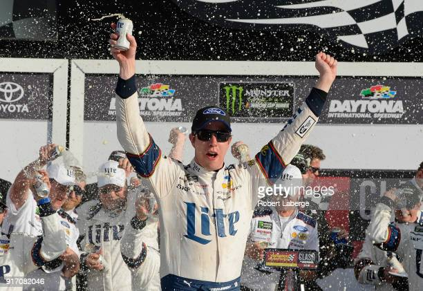 Brad Keselowski driver of the Miller Lite Ford celebrates in Victory Lane after winning the Monster Energy NASCAR Cup Series Advance Auto Parts Clash...