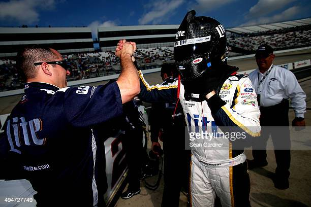 Brad Keselowski driver of the Miller Lite Ford celebrates winning the pole position during qualifying for the NASCAR Sprint Cup Series FedEx 400...